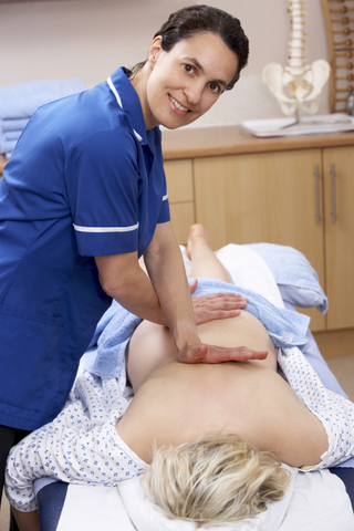 Osteopath treating female client